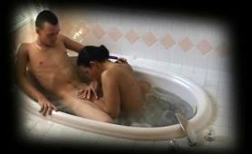 buxom-brunette-delivers-a-wonderful-blowjob-in-the-bathtub