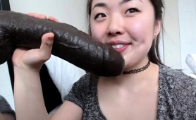 naughty-asian-camgirl-with-nice-tits-sucks-a-huge-black-toy