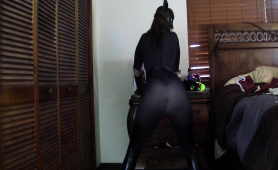 masked-dominatrix-in-a-sexy-black-outfit-flaunts-her-curves