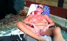 stacked-mature-blonde-enjoys-the-sun-and-plays-with-her-cunt