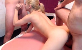 petite-blonde-slut-takes-on-two-throbbing-poles-on-webcam
