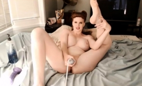 bodacious-redhead-milf-takes-herself-to-climax-with-sex-toys