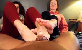 Two Sensuous Brunettes Pleasing A Black Cock With Their Feet
