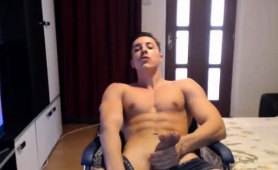 muscled-stud-sensually-strokes-his-big-rod-on-the-webcam